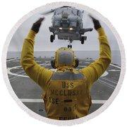 Petty Officer Guides An Sh-60r Sea Hawk Round Beach Towel