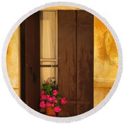 Pink Geraniums Brown Shutters And Yellow Window In Italy Round Beach Towel