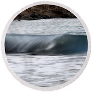 playing with waves 1 - A beautiful image of a wave rolling in noth coast of Menorca Round Beach Towel