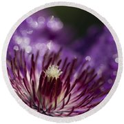 Purple Clematis And Bokeh Round Beach Towel