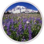 Purple Flowers Blooming Beneath Mount Round Beach Towel