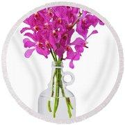 Purple Orchid In Bottle Round Beach Towel by Atiketta Sangasaeng