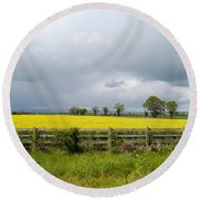 Rain Clouds Over Canola Field Round Beach Towel