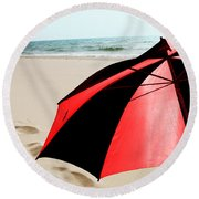 Red And Black Umbrella On The Beach With Footprints Round Beach Towel