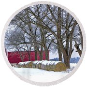 Red Barn In Winter With Hay Bales Round Beach Towel