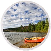 Red Canoe On Lake Shore Round Beach Towel
