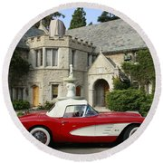 Red Corvette Outside The Playboy Mansion Round Beach Towel