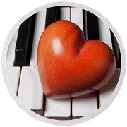 Red Stone Heart On Piano Keys Round Beach Towel