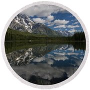 Reflections On Mount Moran Round Beach Towel