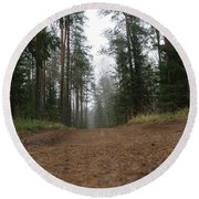 Road In A Pine Grove Round Beach Towel