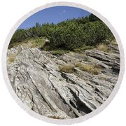 Rock And Sky Round Beach Towel