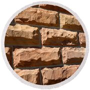 Rough Hewn Sandstone Brick Wall Of A Historic Building Round Beach Towel