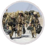 Royal Marines Haul Their Equipment Round Beach Towel