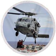 Sailors Hook An Ammunition Pallet To An Round Beach Towel