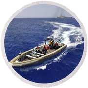 Sailors Transit An Inflatable Boat Round Beach Towel