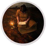 Schoolgirl Sitting On Wood Floor Reading By Candlelight Round Beach Towel