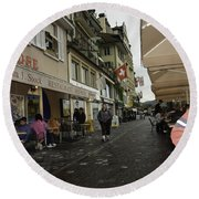 Seated In The Cafe Along The River In Lucerne In Switzerland Round Beach Towel
