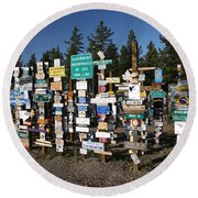 Sign Posts Forest In Watson Lake Yukon Round Beach Towel by Mark Duffy