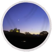 Silhouette Of A Castle On The Cliff Of Round Beach Towel