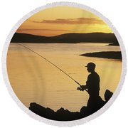 Silhouette Of A Fisherman Fishing On Round Beach Towel
