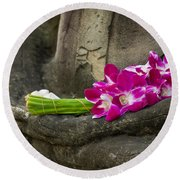 Sitting Buddha In Meditation Position With Fresh Orchid Flowers Round Beach Towel
