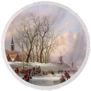 Skaters On A Frozen River Before Windmills Round Beach Towel