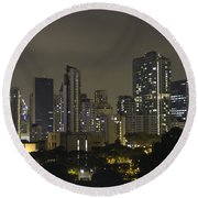 Skyline Of Singapore At Night As Seen From An Apartment Complex Round Beach Towel