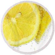 Sliced Lemon In Fizzy Water Round Beach Towel