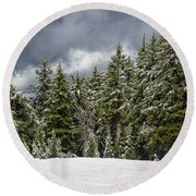 Snowstorm In The Cascades Round Beach Towel