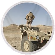 Soldier Climbs A Damaged Husky Tactical Round Beach Towel by Stocktrek Images