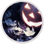 Spooky Jack-o-lantern On Fallen Leaves Round Beach Towel