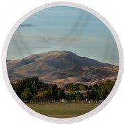 Sport Complex And The Butte Round Beach Towel