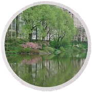Spring Reflections Of Manhattan In Central Park Round Beach Towel