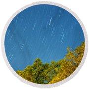 Star Trails On A Blue Sky Round Beach Towel