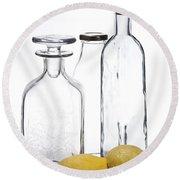 Still Life Of Bottles  And Lemons Round Beach Towel