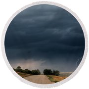 Storm Clouds And Lightning Along A Saskatchewan Country Road Round Beach Towel