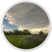 Storm Clouds Gather Over An Abandoned Round Beach Towel