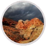 Stormy Skies Over Valley Of Fire Round Beach Towel