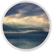 Sunlight And Clouds Over An Alpine Lake Round Beach Towel