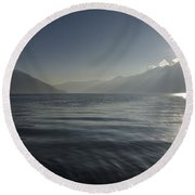 Sunlight Over An Alpine Lake Round Beach Towel