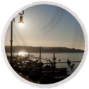 sunrise - First dawn of a spanish town is Es Castell Menorca sun is a special lamp Round Beach Towel