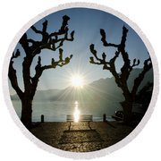Sunset Over A Lake With Trees Round Beach Towel