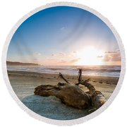 Sunset Over A Misty Beach Round Beach Towel