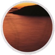 Sunset Over Dunmore Head Round Beach Towel