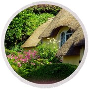 Thatched Cottage With Pink Flowers Round Beach Towel
