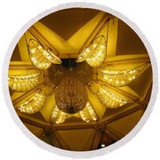 The Beautifully Lit Chandelier On The Ceiling Of The Iskcon Temple In Delhi Round Beach Towel