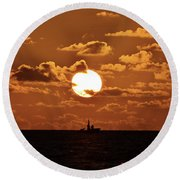 the Bronzy Sunset. Round Beach Towel
