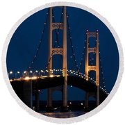 The Mackinaw Bridge At Night By The Straits Of Mackinac Round Beach Towel