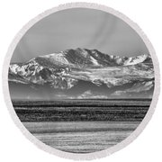 The Rockies Round Beach Towel by Heather Applegate