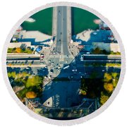 The Shadow Of The Eiffel Tower Round Beach Towel